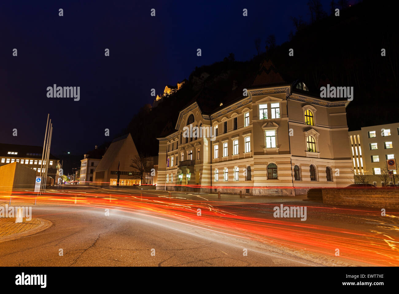 Parliament building in Vaduz during the evening traffic. Vaduz, Liechtenstein. - Stock Image