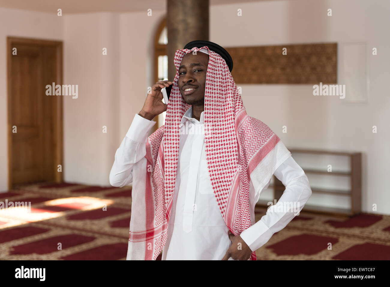 Arab Saudi Emirates Man Using A Smart Phone - Stock Image