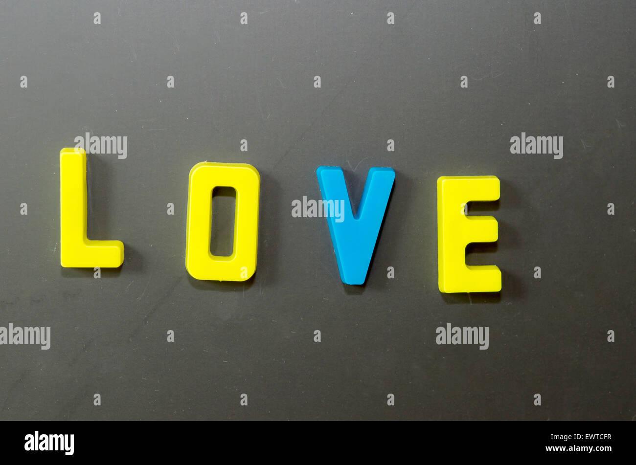 Love letters stuck on a blackboard. Stock Photo