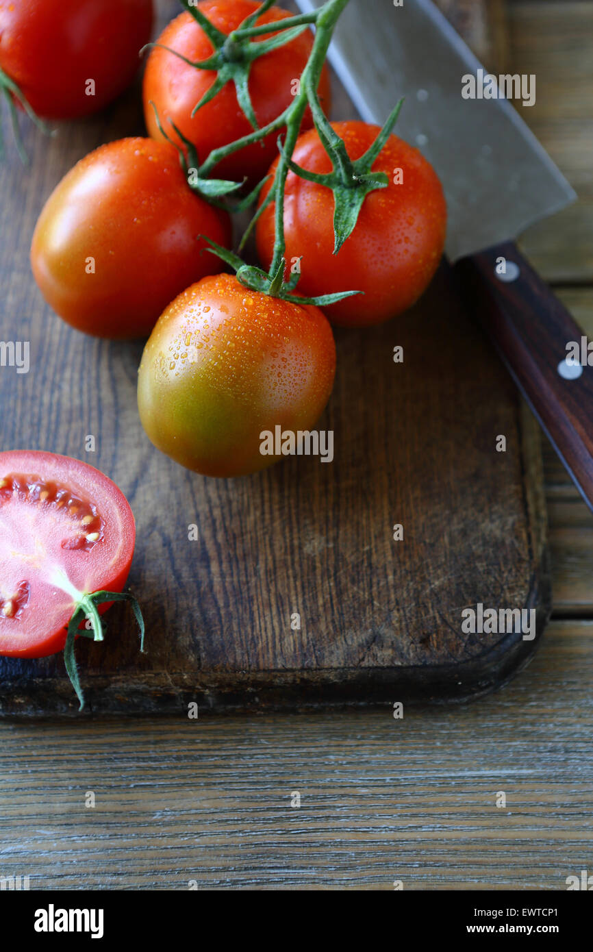 branch of red tomatoes, healthy food - Stock Image