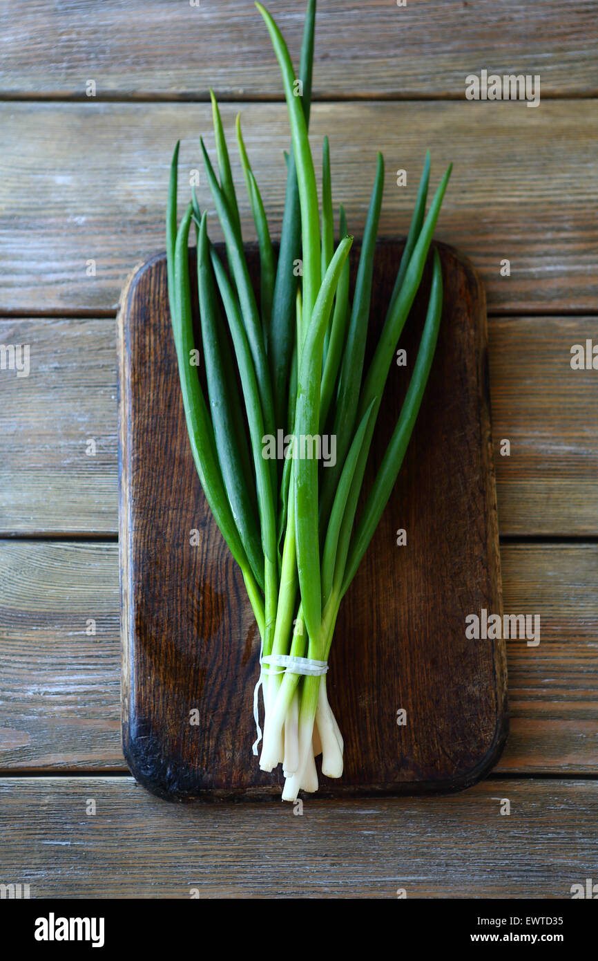 green onion on the chopping board, top view - Stock Image