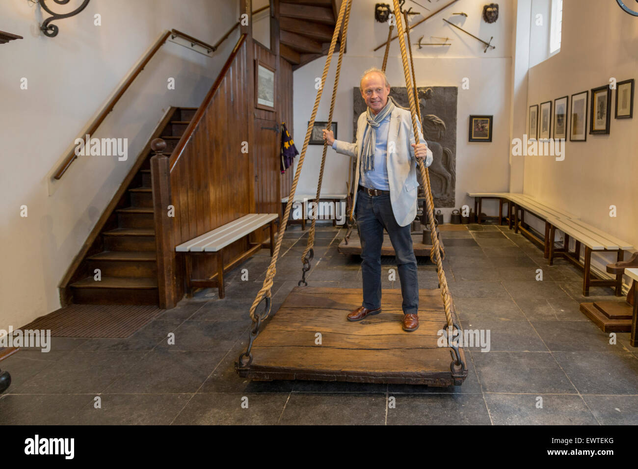 Interior of the Witches' Weigh House (Heksenwaag) with a man being weighed on the scales, in Oudewater, Utrecht, - Stock Image