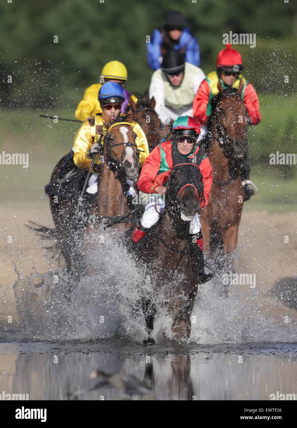 Hamburg, Germany. 30th June, 2015. Equastrian Vlastislav Korytar on his horse Audientia leads the field of jockeys - Stock Image