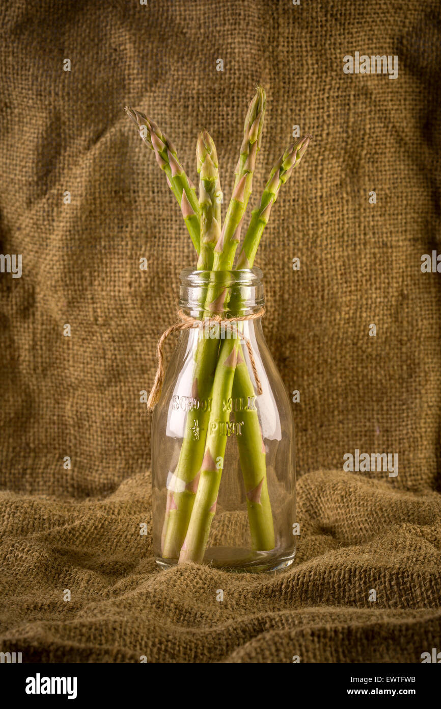 A bunch of Asparagus in a bottle. - Stock Image