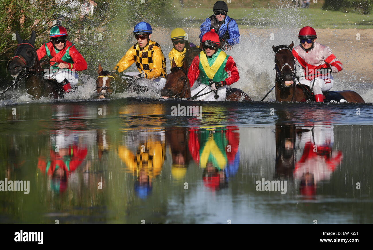 Hamburg, Germany. 30th June, 2015. equestrian Cevin Chan on Kazzio (2nd L) and a field of jockeys chase their horses - Stock Image