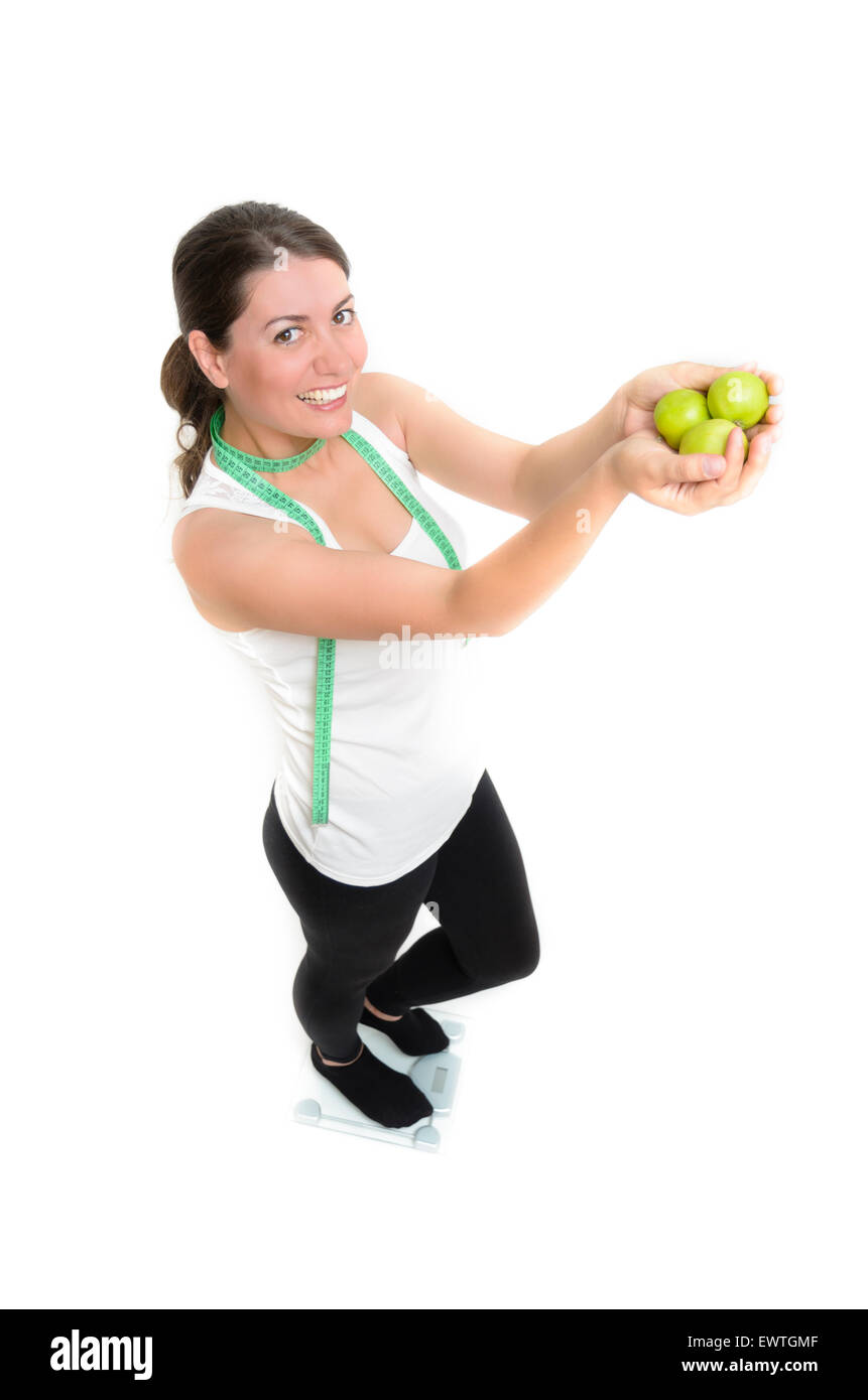 a sporty girl holding some apples - Stock Image