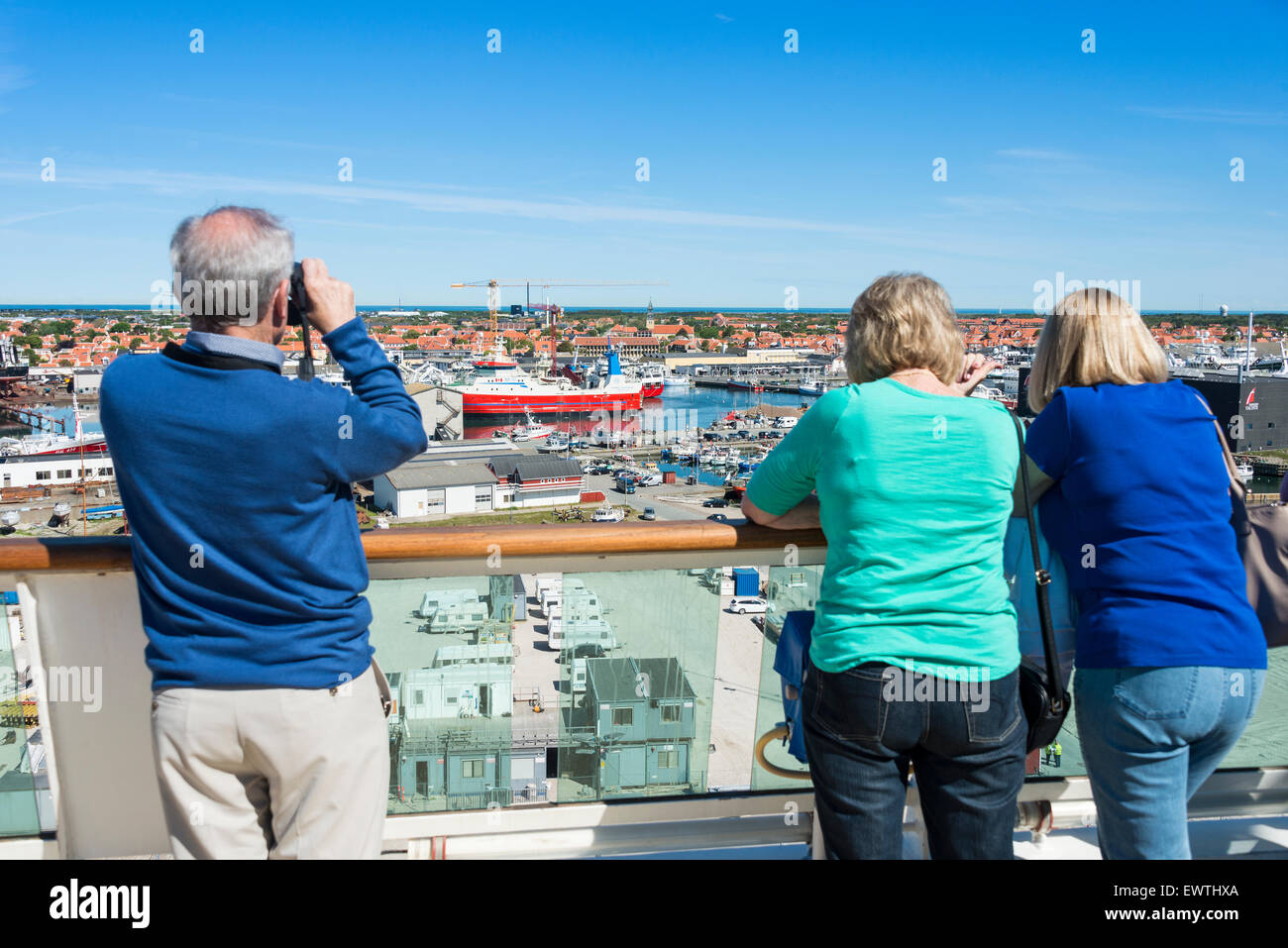 Passengers viewing from deck of Royal Caribbean 'Brilliance of the seas' cruise ship, Skagen, North Jutland - Stock Image