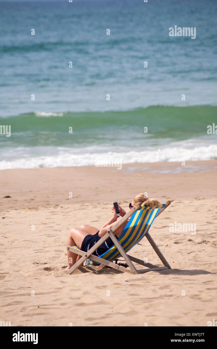 Bournemouth, Dorset, UK 1 July 2015. UK weather: hot sunny day at Bournemouth Beach - sunseekers flock to the seaside - Stock Image