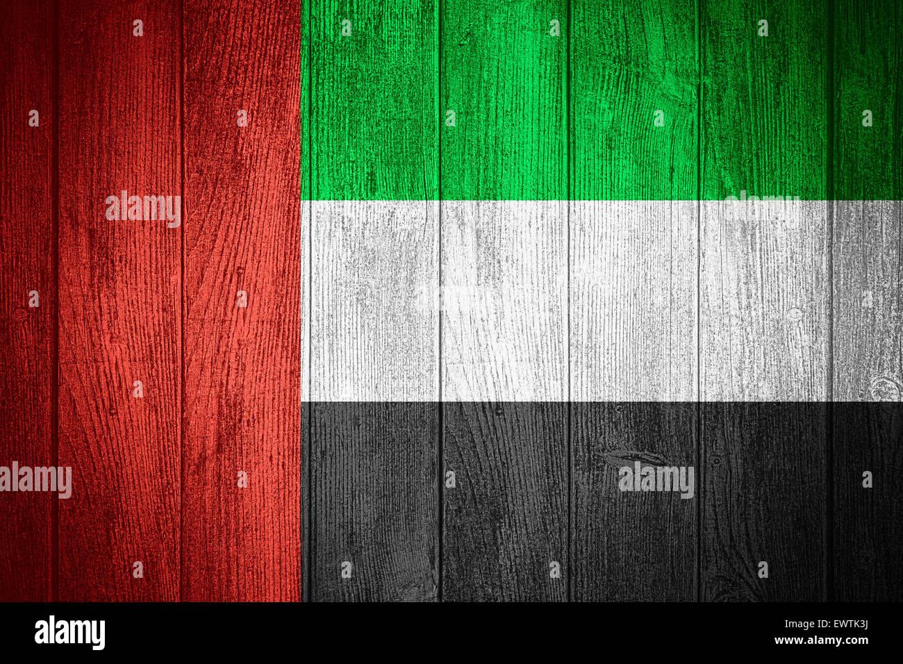 united arab emirates flag or uae banner on wooden boards background