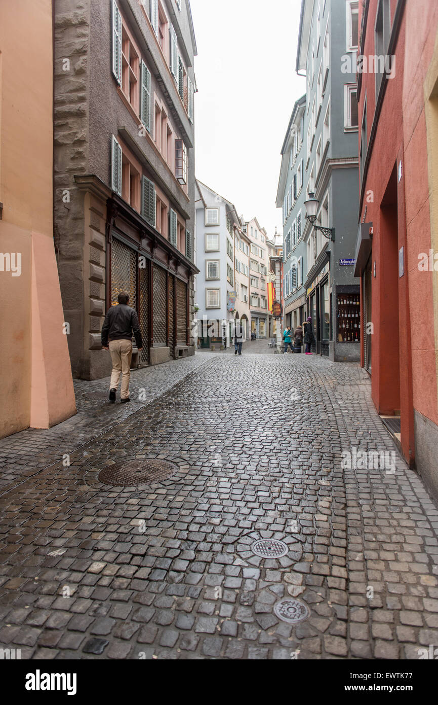 Narrow cobblestone lane with shops in Zurich Switzerland, Europe Stock Photo