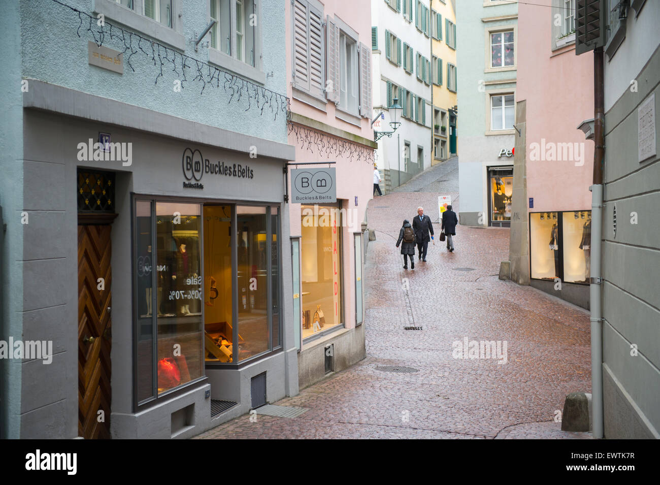 Narrow cobblestone lane with boutique shops in Zurich Switzerland, Europe - Stock Image