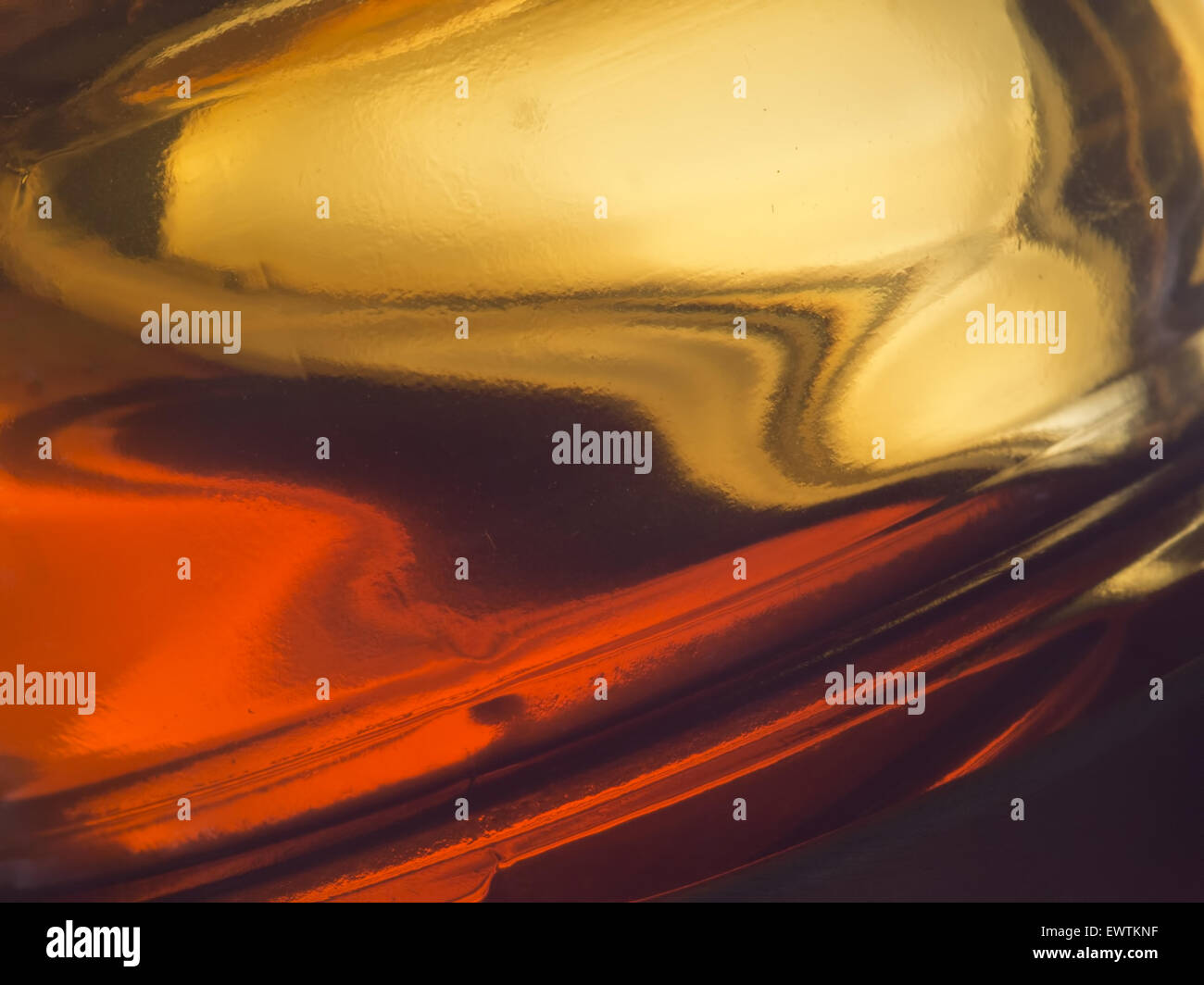 Runny honey detail. Farm produced honey in thick glass pot. - Stock Image