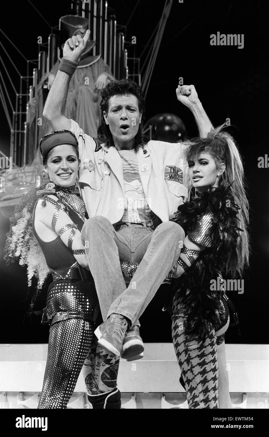 Cliff Richard and the cast of the musical 'Time' attend a photocall held at the Dominion Theatre. 25th March - Stock Image