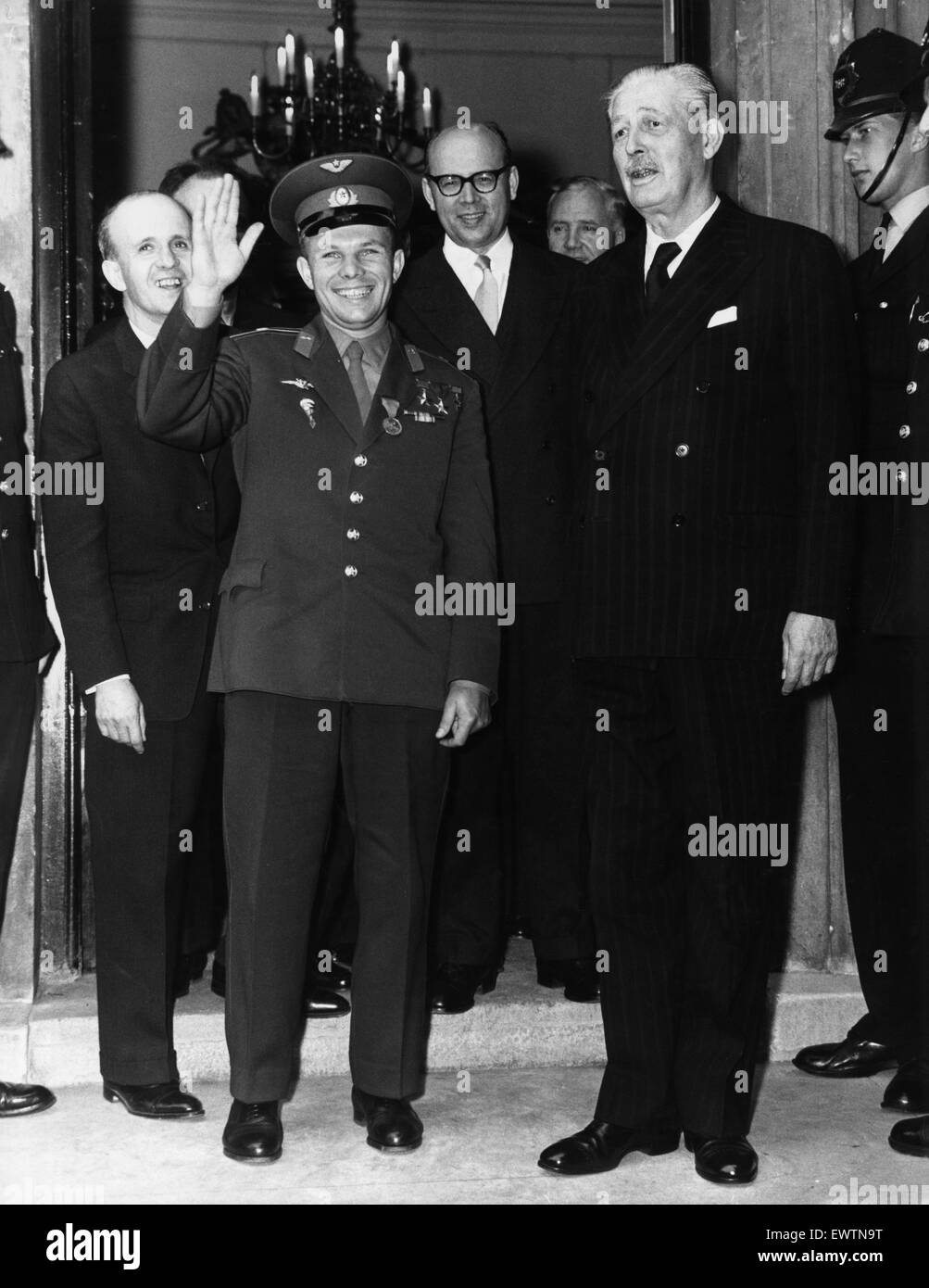 Yuri Gagarin seen here with Prime Minister Harold Macmillan at Admiralty House. The Russian astronaut waves to the - Stock Image