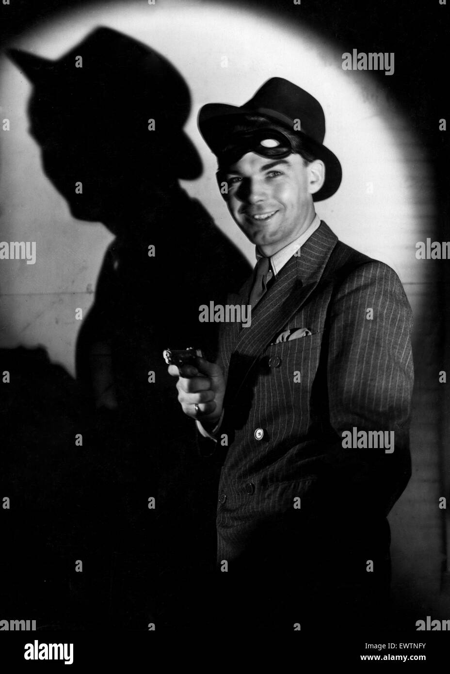 Gunman, studio shoot for Mirror feature 'Would You Kill A Man for £700' 23rd September 1937 - Stock Image