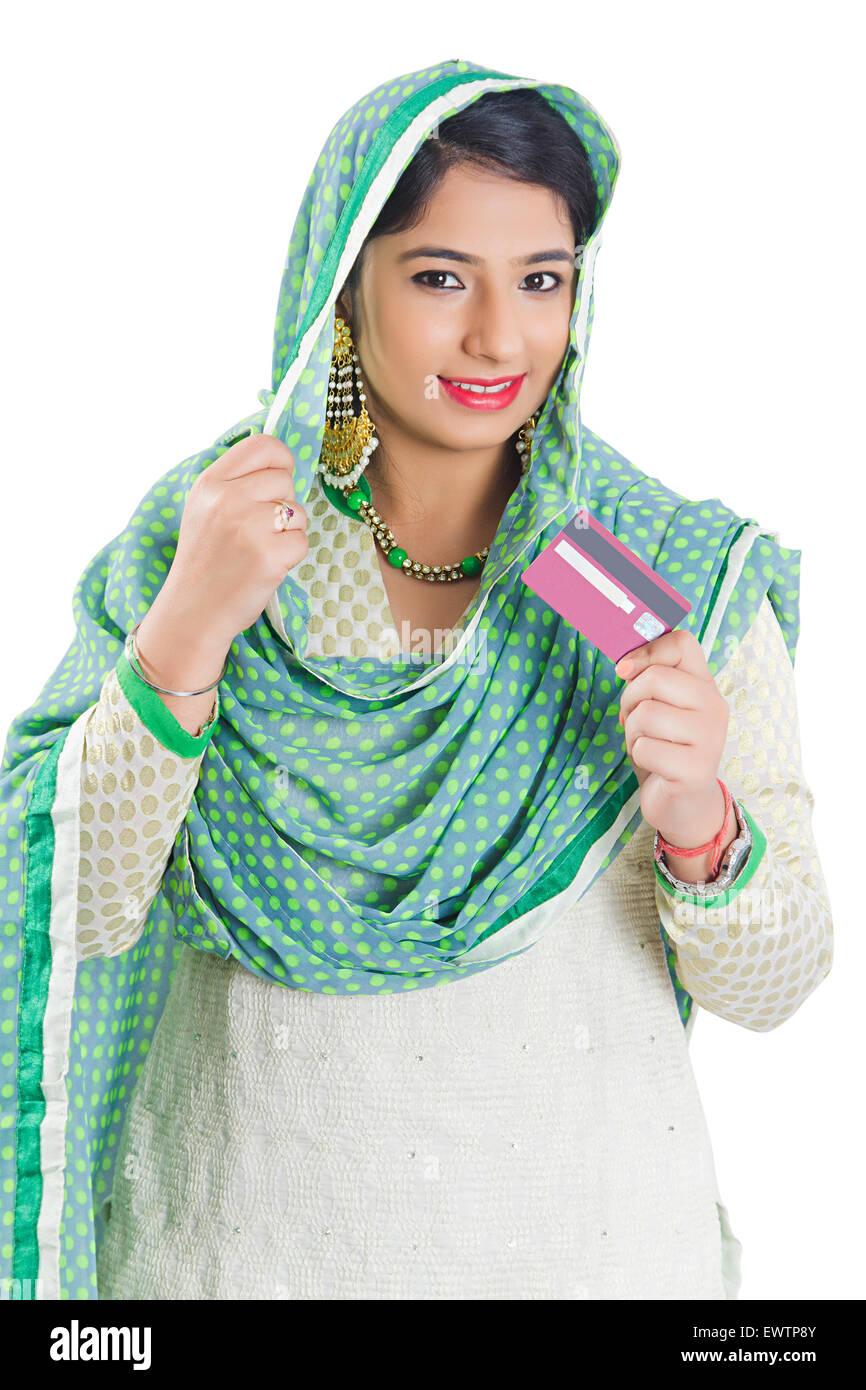 1 indian Muslim woman Credit Card showing - Stock Image