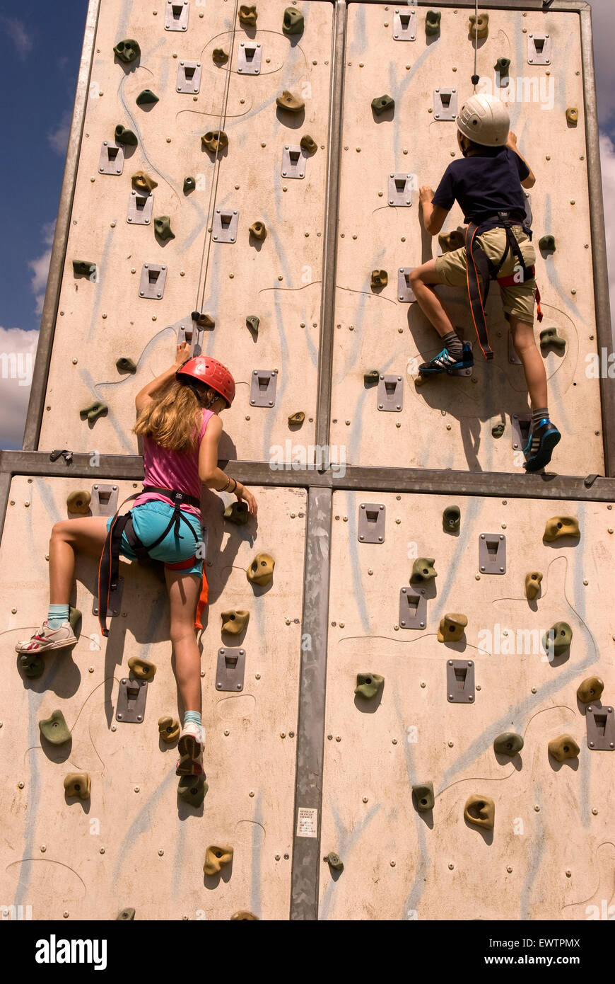 Youngsters using the climbing wall at the Farewell to the Garrison Festival, Bordon, Hampshire, UK. Saturday 27th - Stock Image