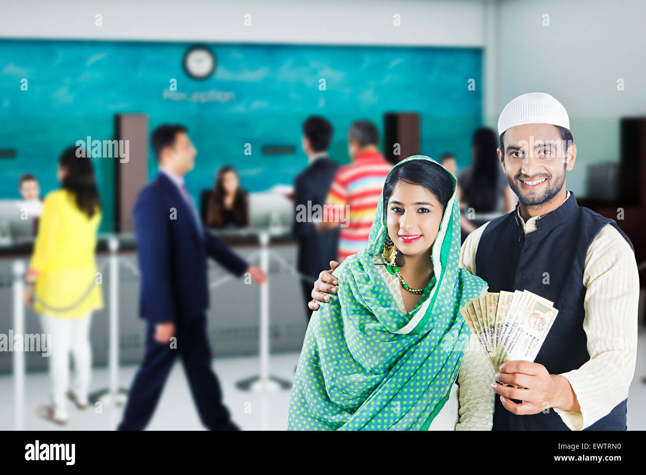 2 indian Muslim Married Couple showing money Stock Photo