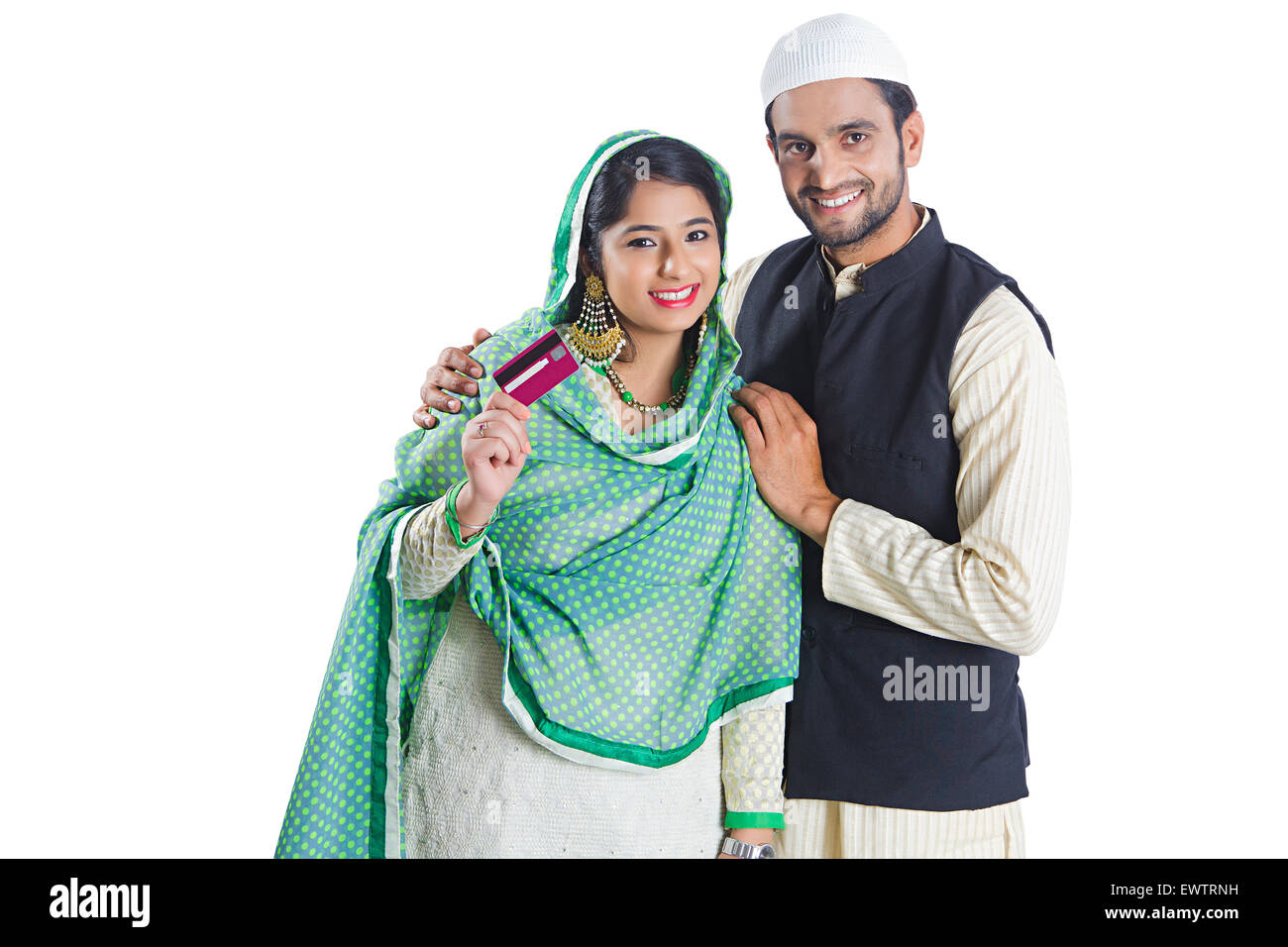 2 indian Muslim Married Couple Credit Card and showing money - Stock Image
