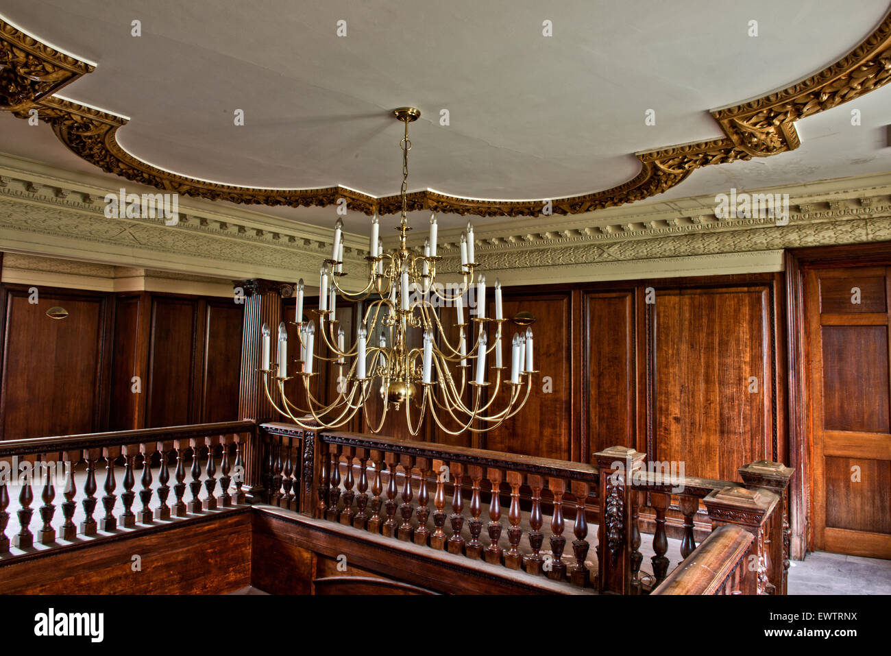 Once grand, the chandelier and staircase inside Silverlands Orphanage, Chertsey, Surrey, UK - Stock Image