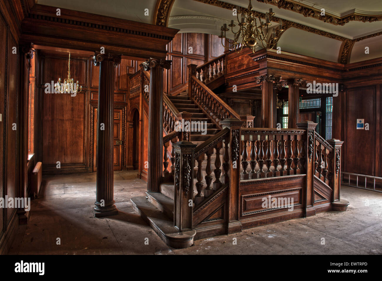 Stunning detail on the carved oak staircase inside Silverlands Orphanage, Chertsey, Surrey, UK - Stock Image