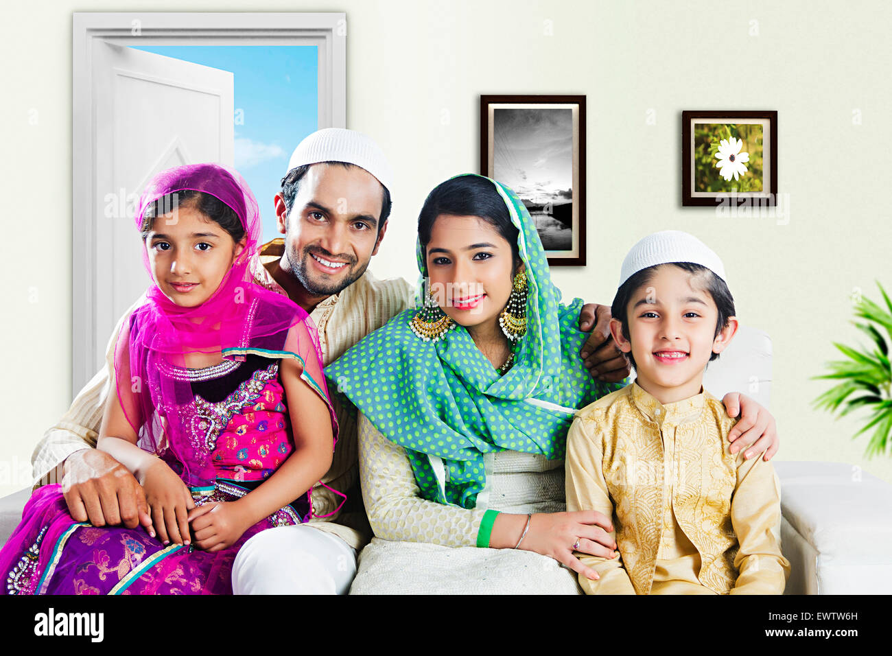 indian Muslim Parents and kids sitting home - Stock Image