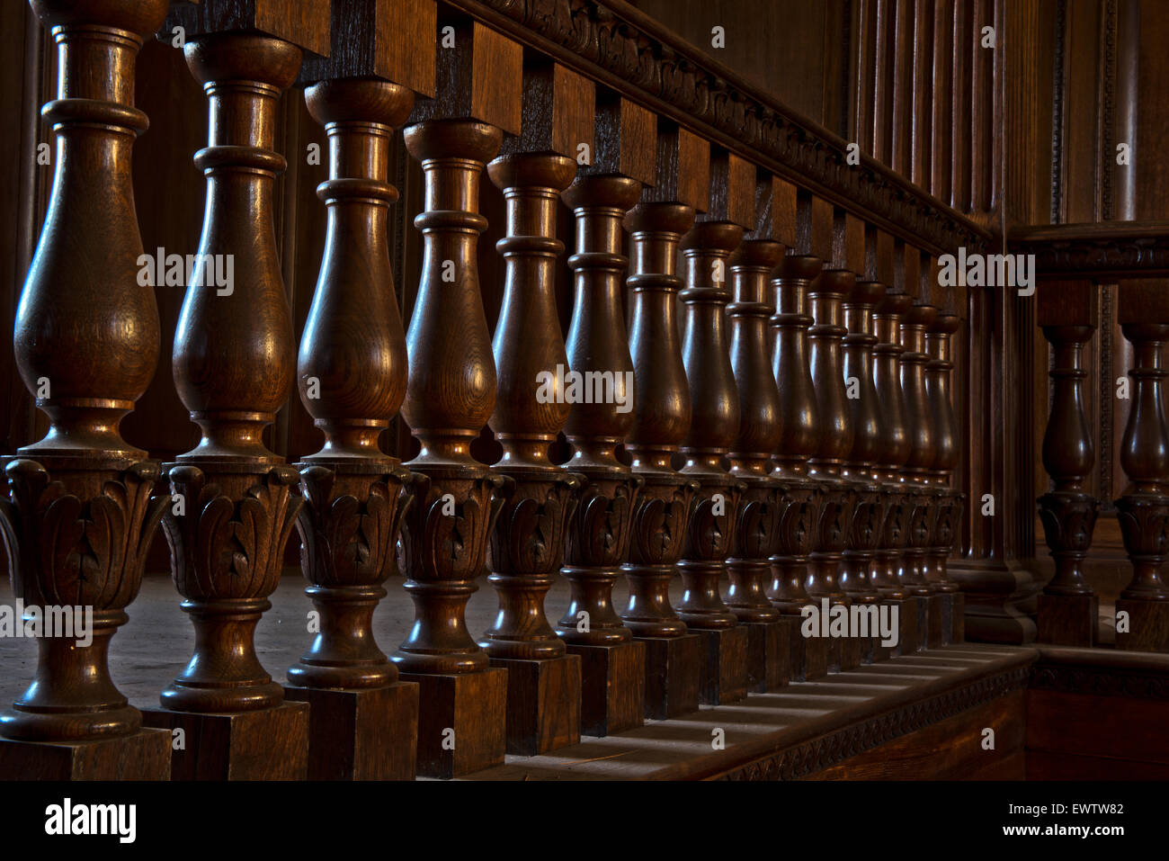 Ornate woodwork on the staircase at Silverlands Orphanage, Chertsey, Surrey, UK - Stock Image