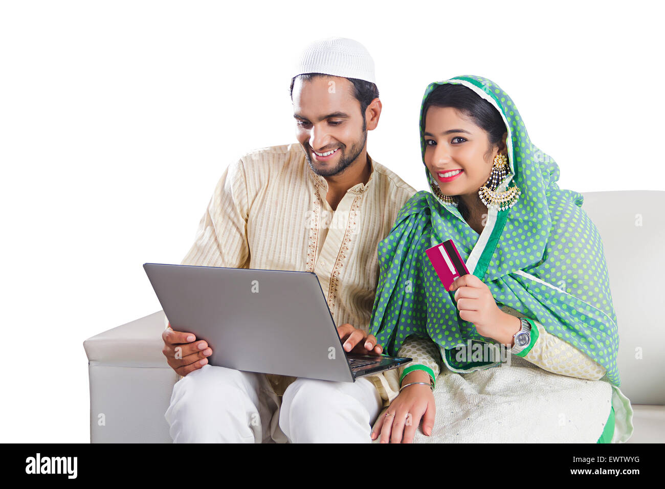 2 indian Muslim Married Couple laptop Credit Card shopping - Stock Image