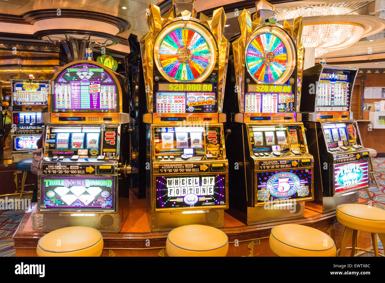 Slot machines in casino on board Royal Caribbean 'Brilliance of the Seas' cruise ship, North Sea, Europe - Stock Image