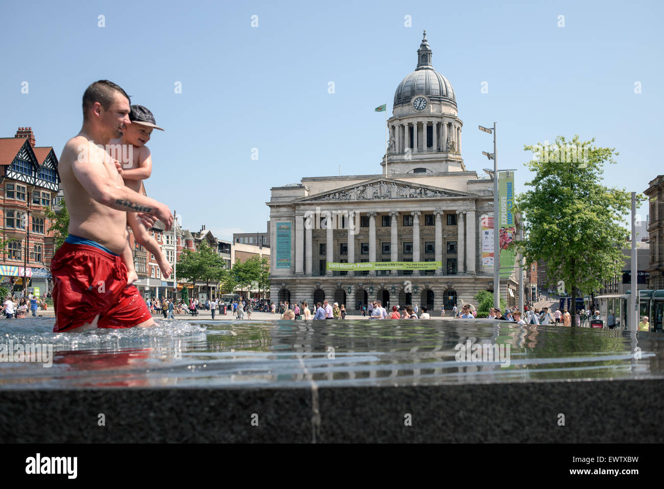 Nottingham, UK. 01st July, 2015. Heat wave hits Nottingham, People keep cool in the old market square fountains - Stock Image