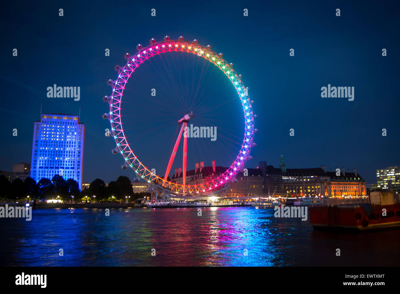 London Eye lit in rainbow for Pride in London 2015 - Stock Image