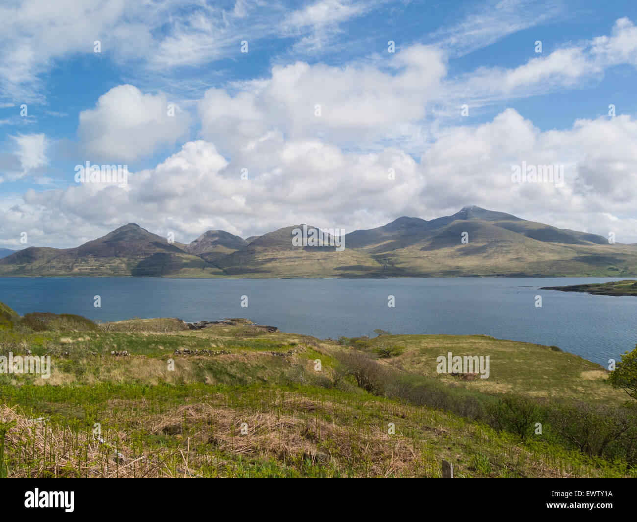View across calm Loch Na Keal towards Ben More one of Munro mountains Isle of Mull Argyll and Bute Scotland on lovely - Stock Image
