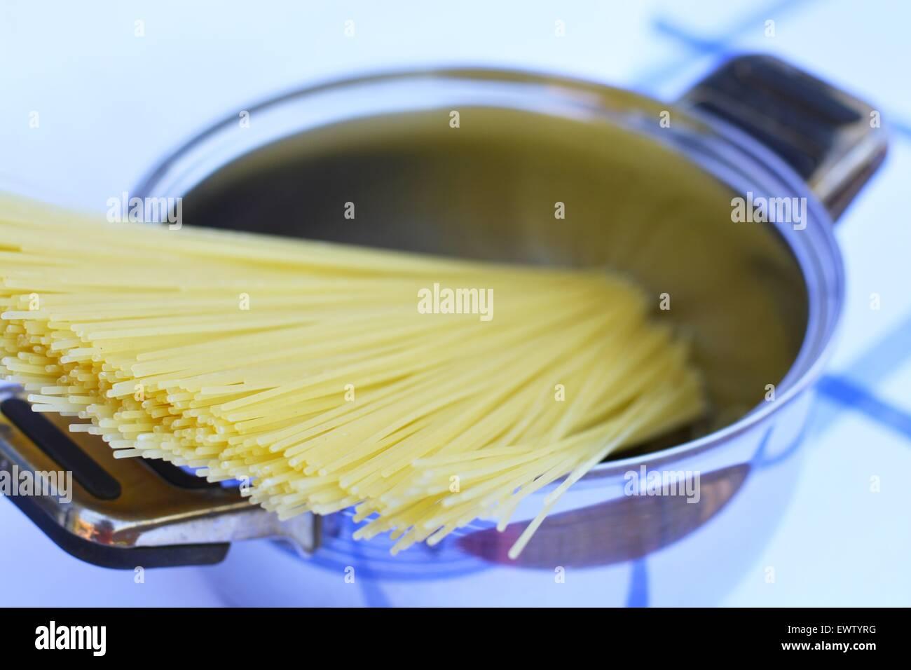 Spaghetti in a pot - Stock Image