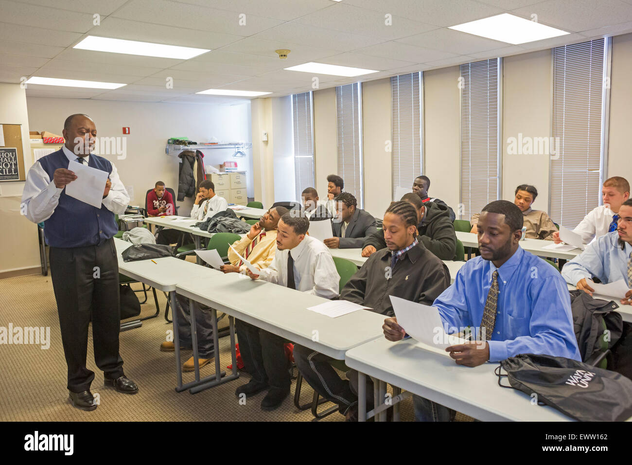 Detroit, Michigan - Young men participate in a financial literacy class as part of a Work Readiness program. - Stock Image