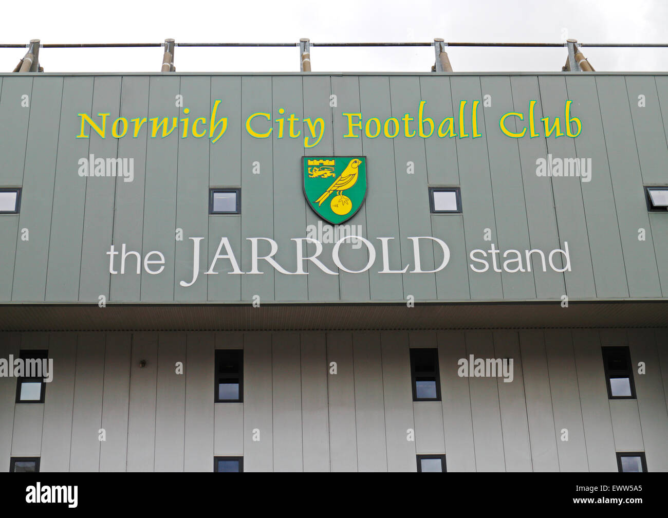 Sign of The Jarrold stand and club badge at the Carrow Road ground of Norwich City Football Club, Norfolk, England, - Stock Image