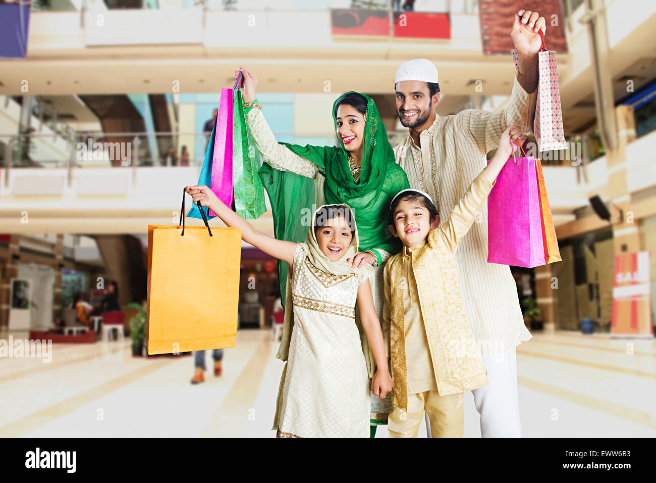 indian Muslim Parents and kids mall shopping - Stock Image