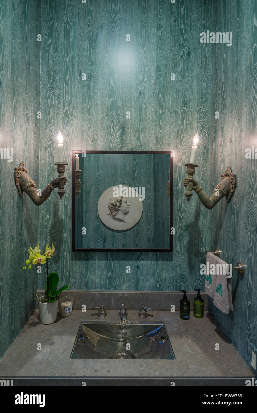 Modern bathroom vanity and sink with matching candle light bulbs - Stock Image