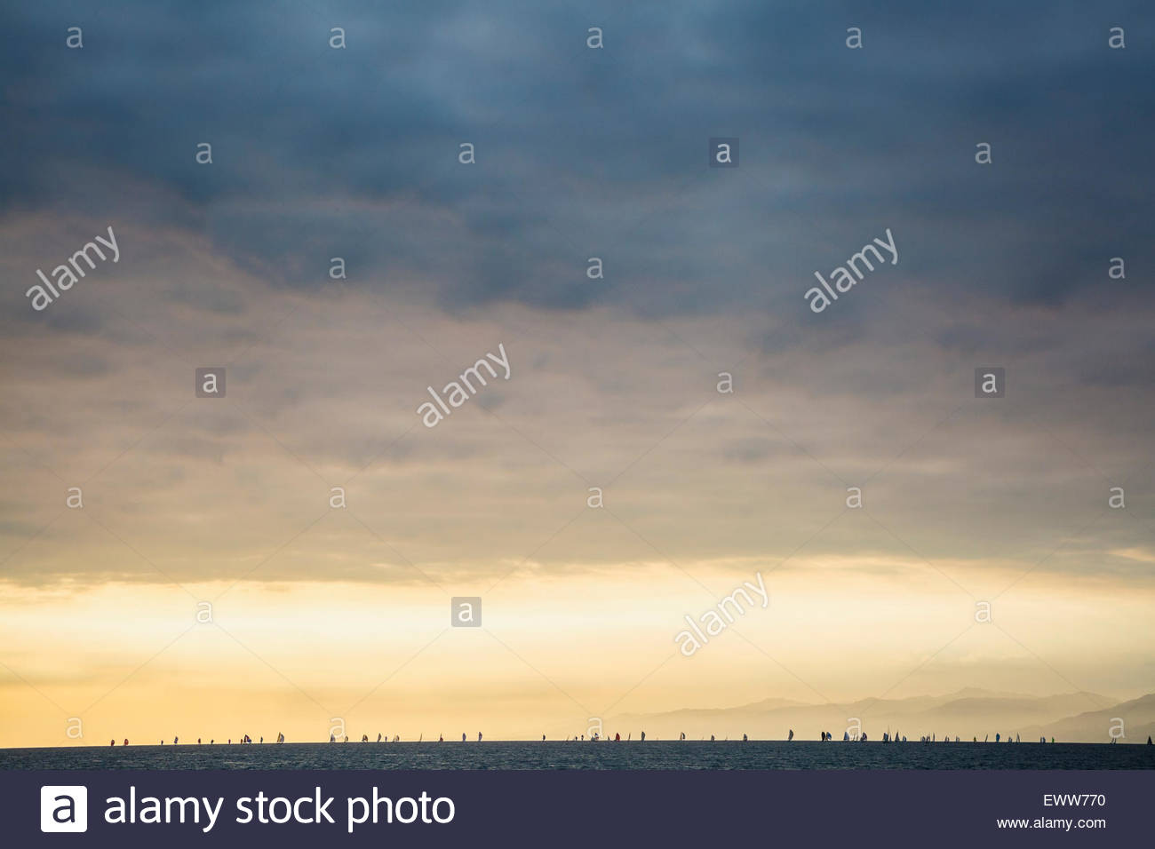 Clouds in sunset sky over ocean - Stock Image