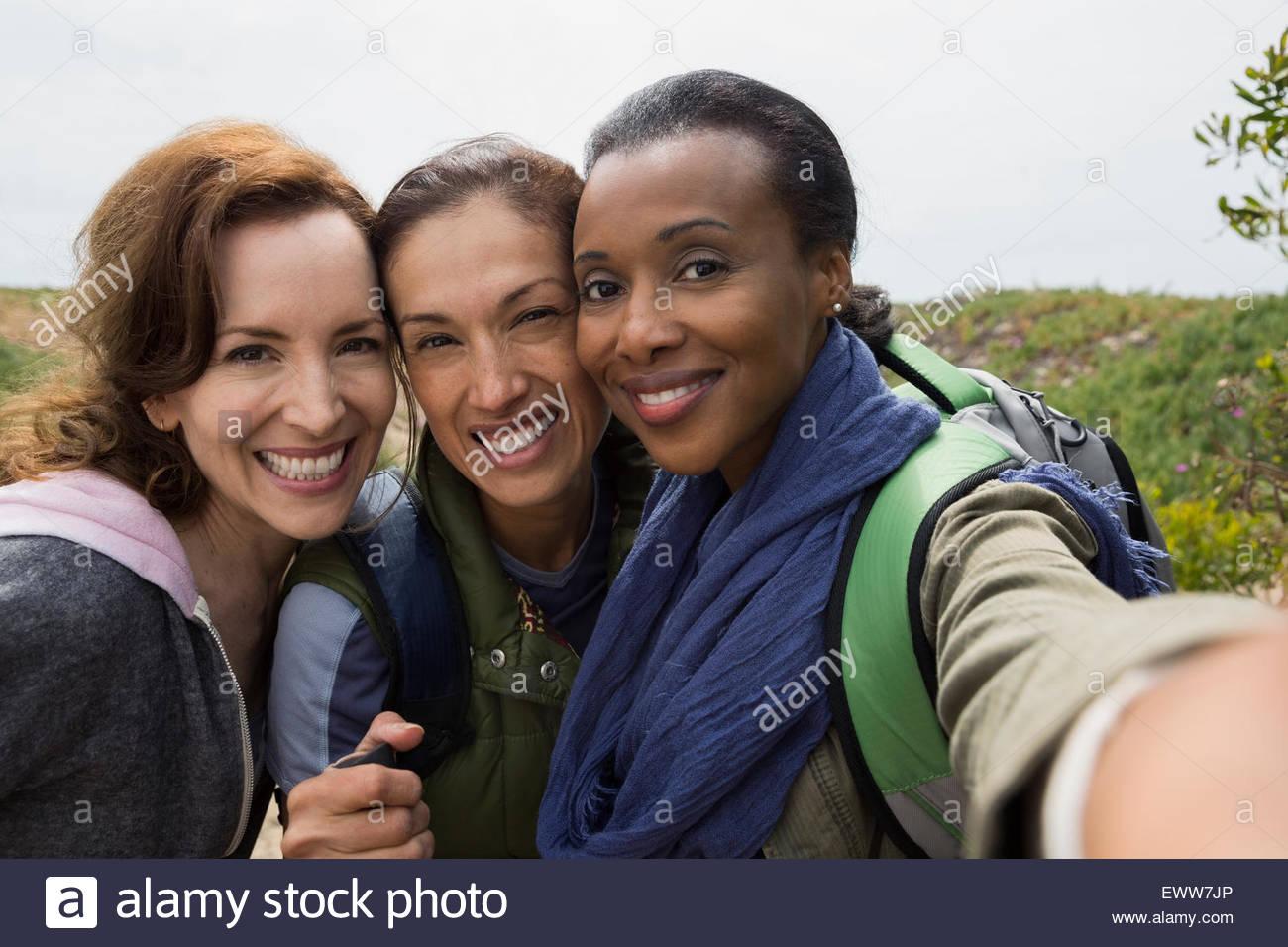 Portrait smiling women hikers - Stock Image