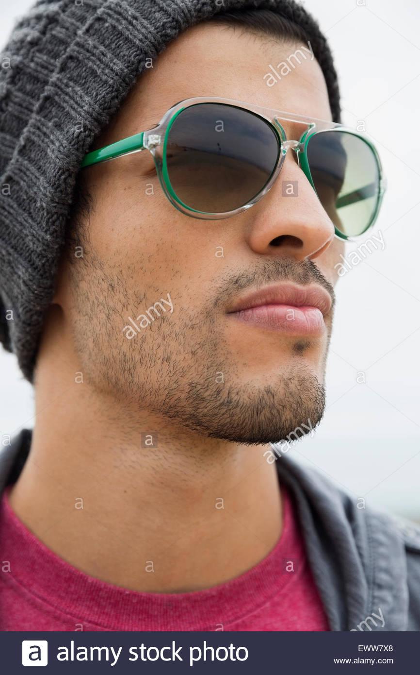 c51cf37553a7 Close up man wearing sunglasses looking away Stock Photo: 84762896 ...