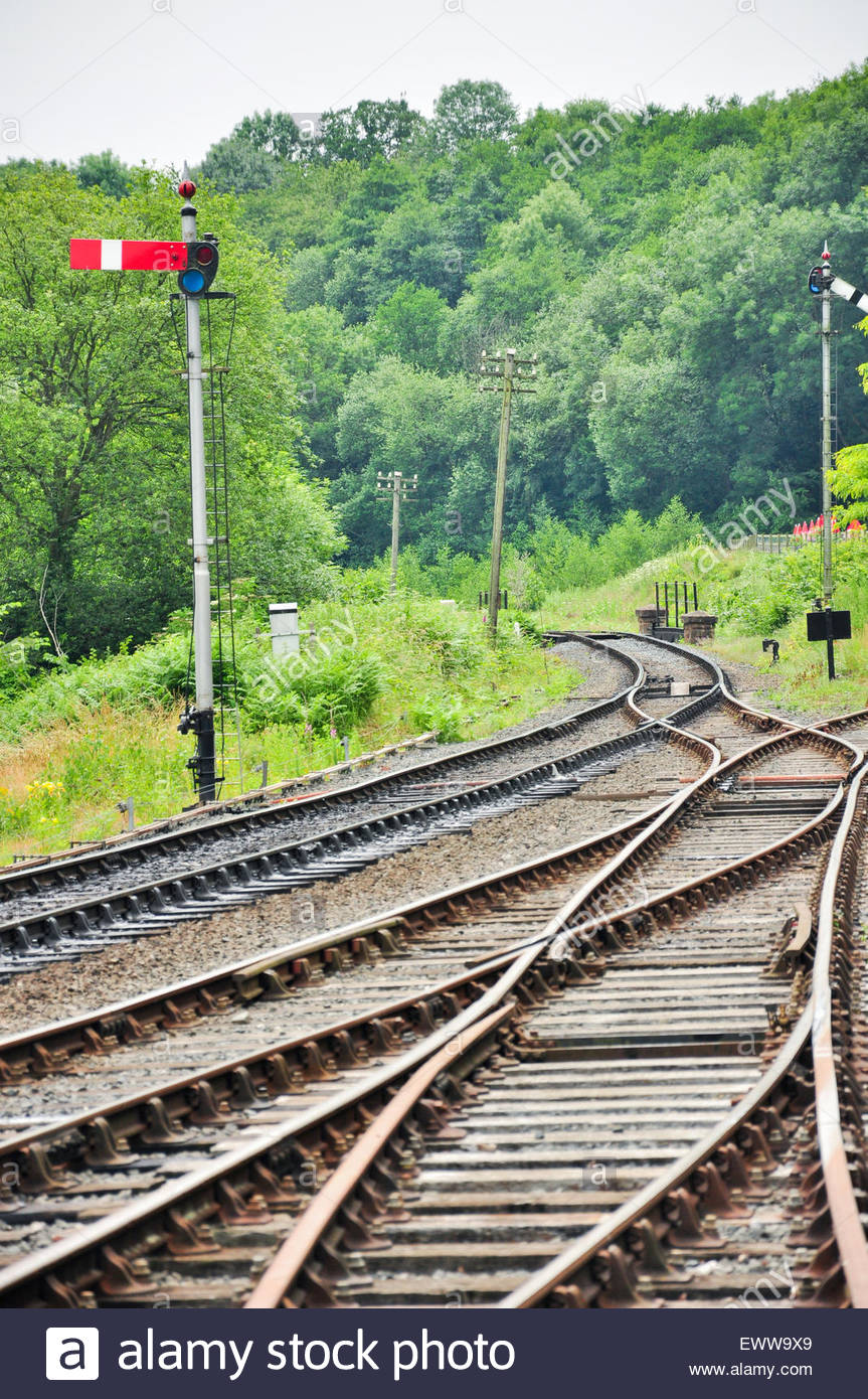 Rail tracks and a railway signal post on the Severn Valley Railway at Highley in Shropshire, UK. - Stock Image