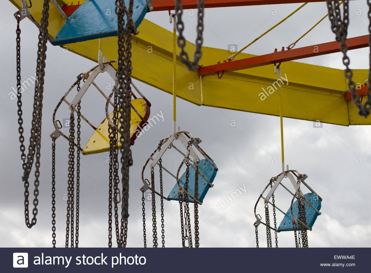 Old rusting swing ride on an Abandoned Amusement Park in the East of England of Cleethorpes - Stock Image