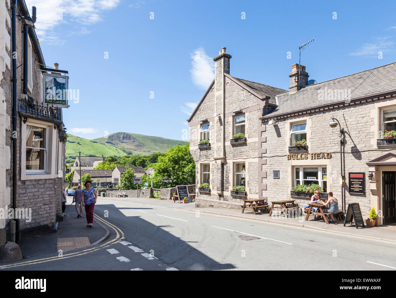 The Castle and The Bull's Head pubs on opposite sides of the road, Castleton, Derbyshire, Peak District National Stock Photo