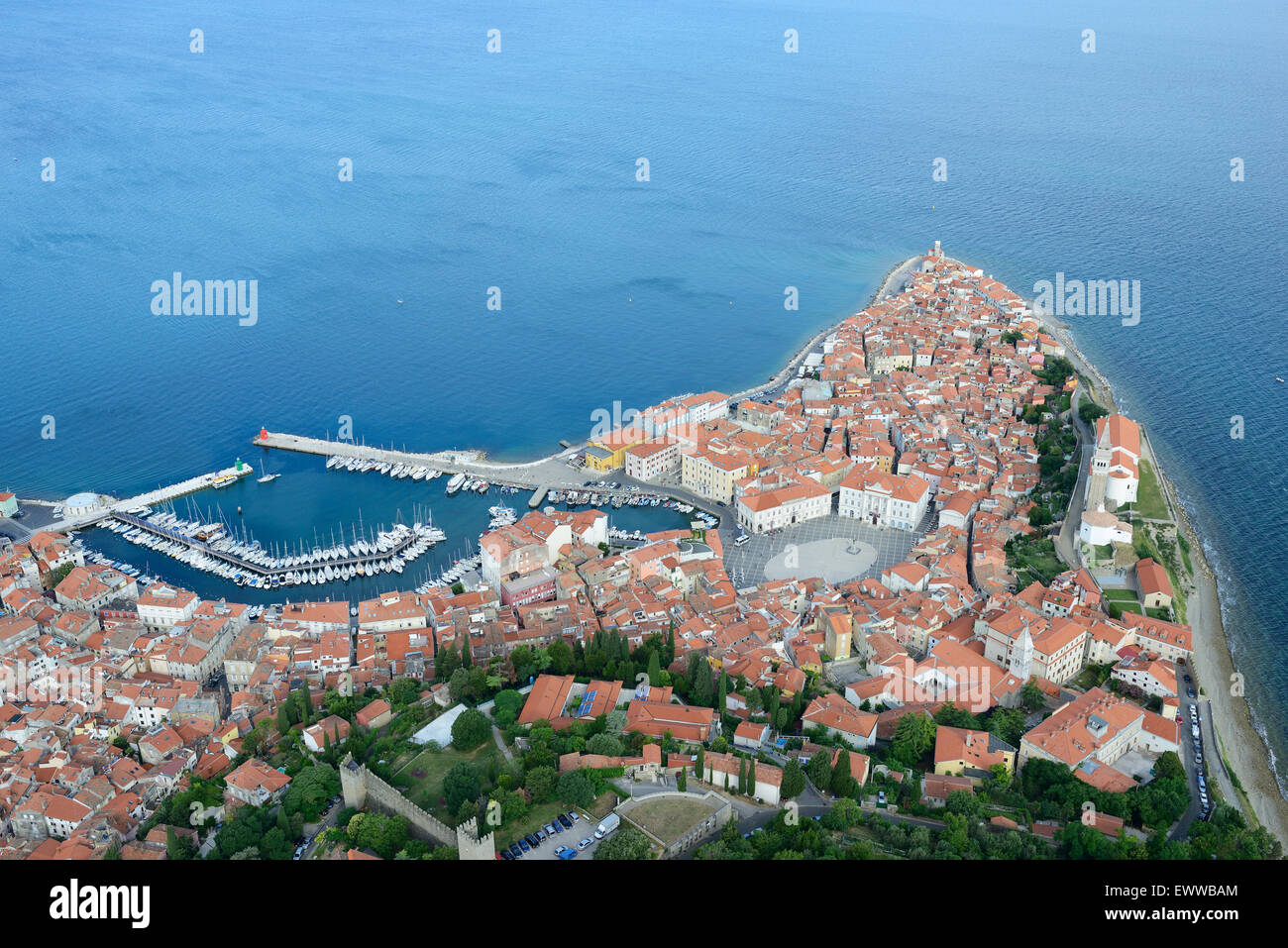 MEDIEVAL CITY JUTTING OUT INTO THE ADRIATIC SEA (aerial view). City of Piran (or Pirano, its Italian name). Slovenia. Stock Photo