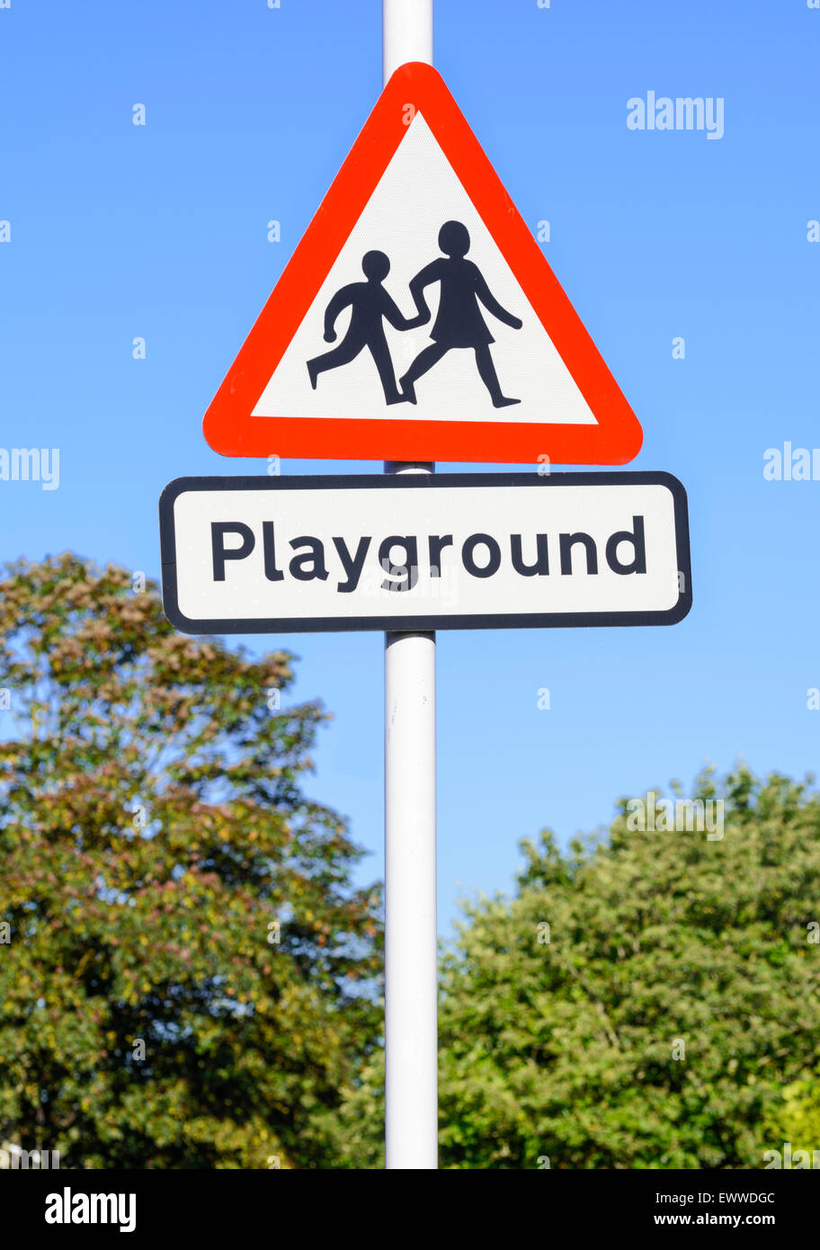 Triangular playground warning sign near a school in the UK. - Stock Image