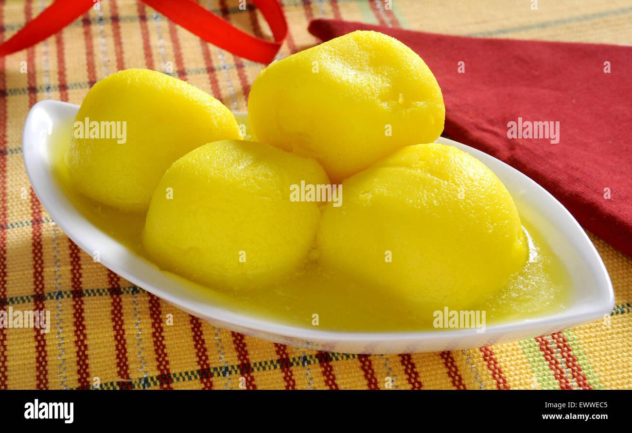 Delicious Pineapple Rusgulla - Stock Image