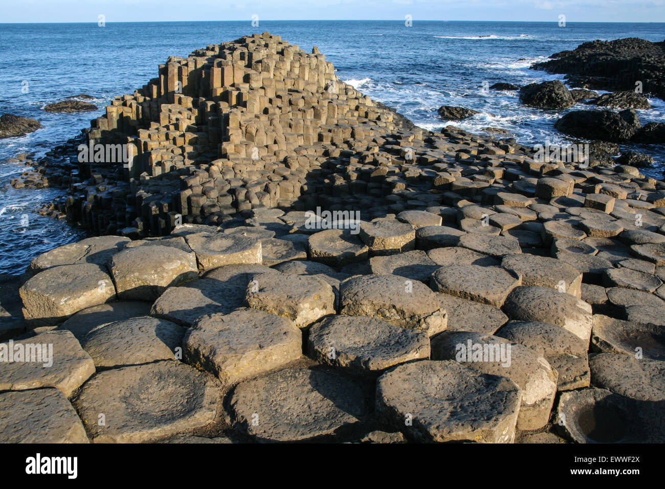 The lunar-like landscape of Giant's Causeway. The Causway is a geological freak, caused by volcanic eruptions - Stock Image