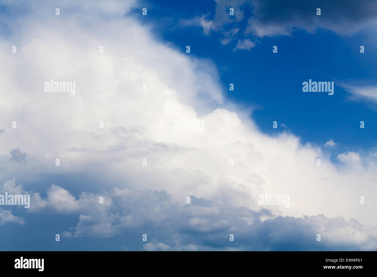 Blue sky with rainy clouds. View from airplane - Stock Image