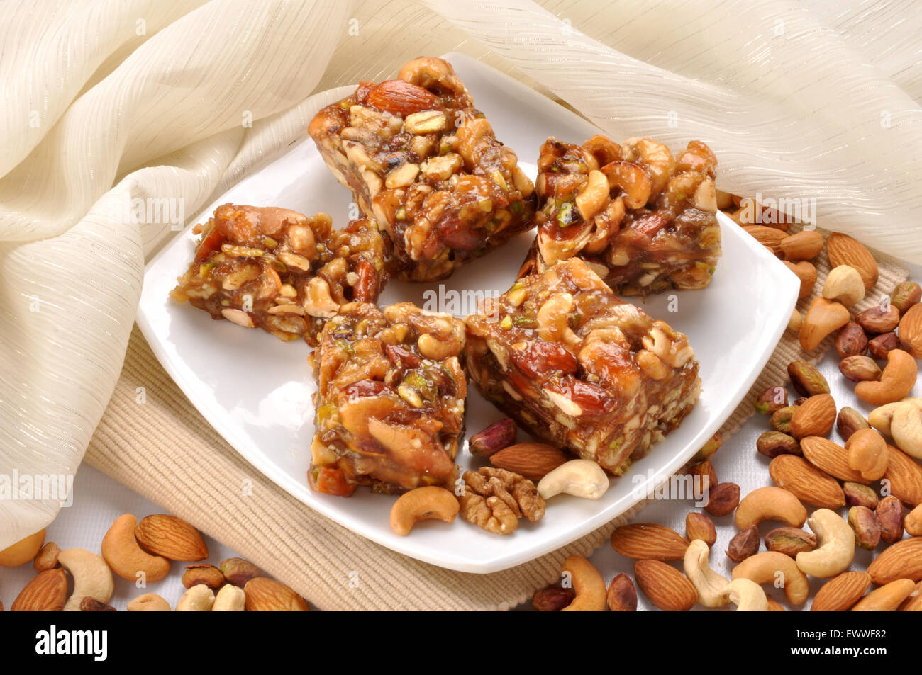 Honey Dry Fruit Halva with silk background - Stock Image