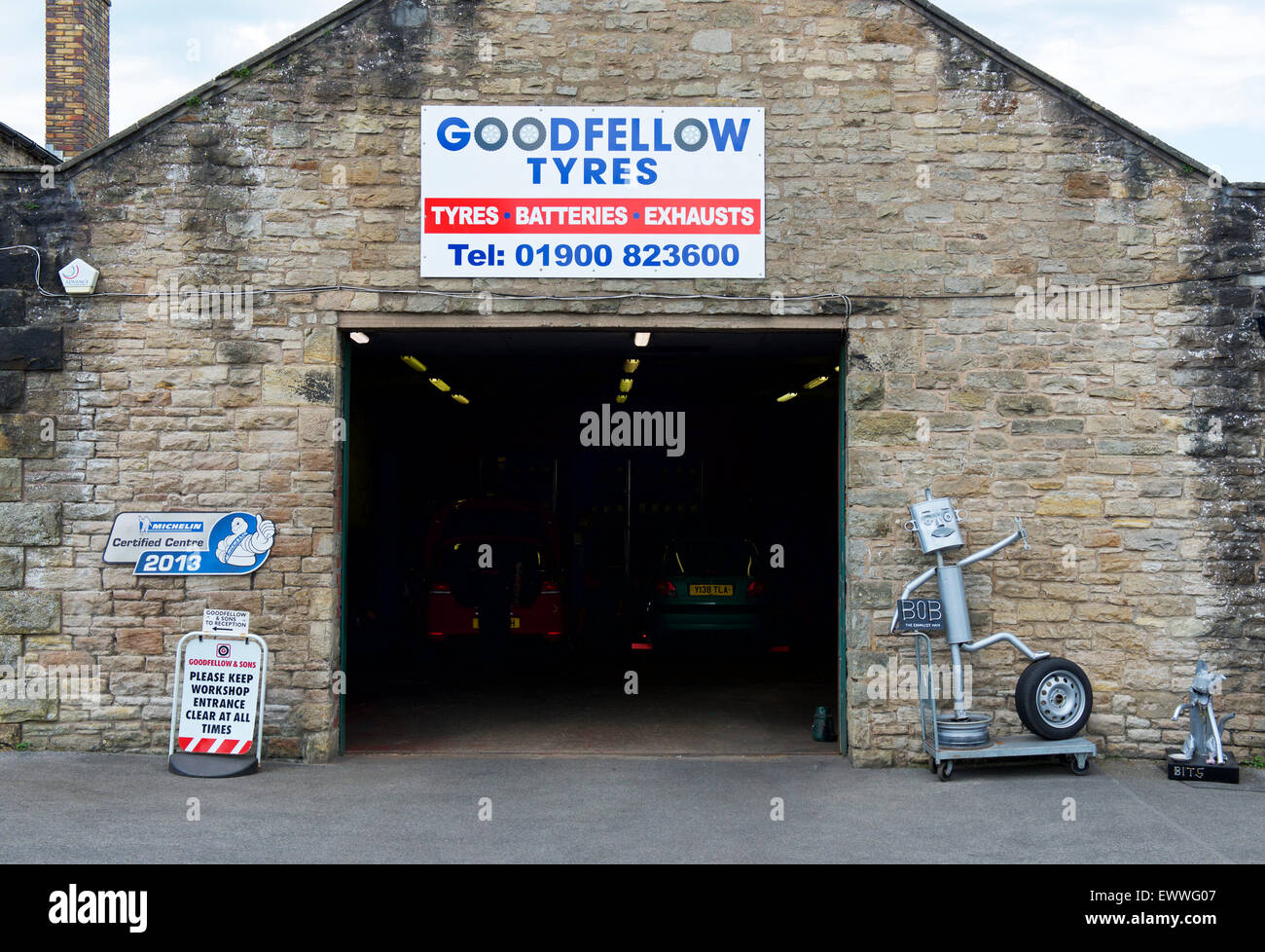 Tyre-fitting workshop, Cockermouth, West Cumbria, England UK - Stock Image
